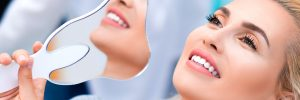 woman happy with dental care